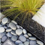 River rock drainage beside lower patio Haynie Residents - contemporary - landsca...