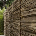 wooden privacy fence (repurposed split rail fencing?), in a Brentwood, Los Angel...