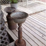 Planter made of an old table leg, an old colander, and a brake drum from an old car! I love this. - Gardening Worlds